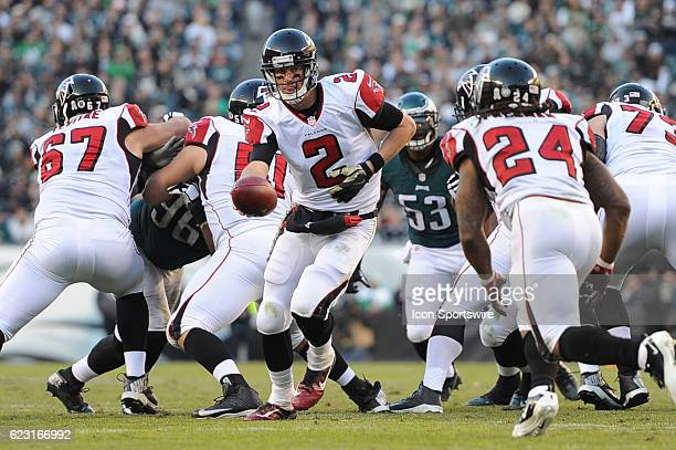 Atlanta Falcons Quarterback Matt Ryan hands off the ball to Atlanta Falcons Running Back Devonta Freeman during a National Football League game...