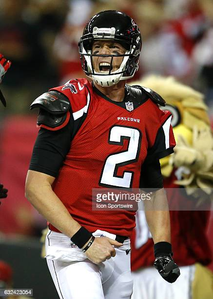 Atlanta Falcons quarterback Matt Ryan reacts after rushing in for a touchdown in the first half of the NFC Championship game between the Green Bay...