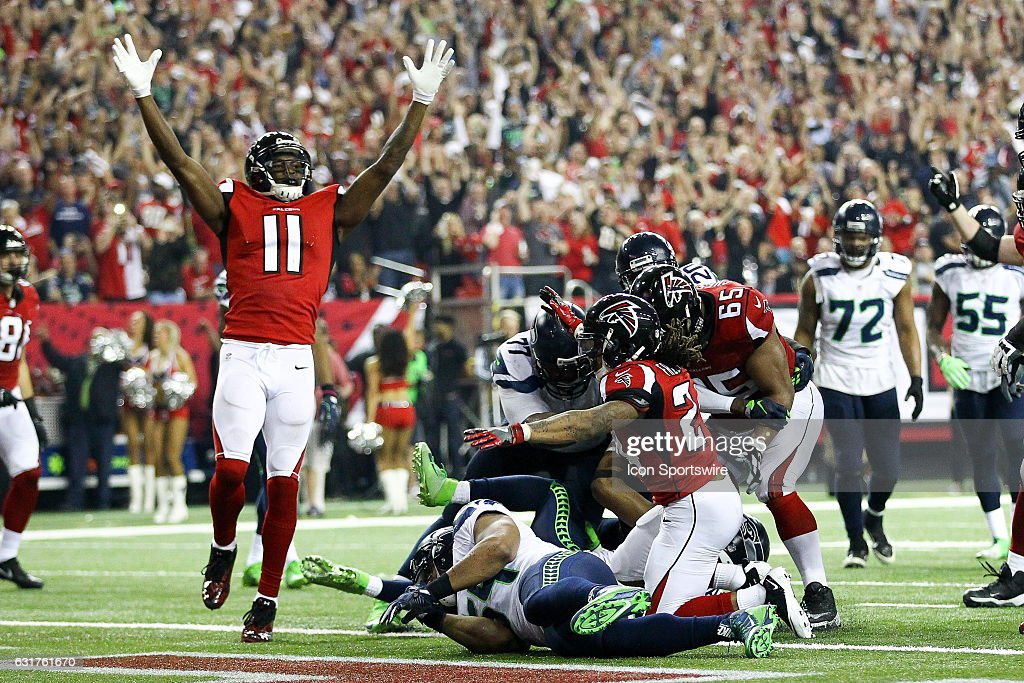 Atlanta Falcons running back Devonta Freeman (24) scores a touchdown during the NFC Divisional Playoff game between the Seattle Seahawks and the Atlanta Falcons on January 14, 2017, at the Georgia Dome in Atlanta, Georgia. The Falcons beat the Seahawks 36-20.