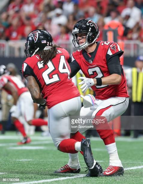 Atlanta Falcons running back Devonta Freeman takes a hand off from Atlanta Falcons quarterback Matt Ryan during the first half of the NFL game...