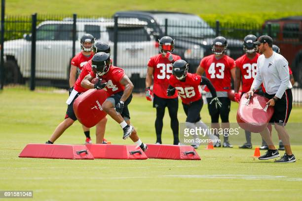 Atlanta Falcons running back Devonta Freeman takes part in a drill during a football practice in Flowery Branch Ga