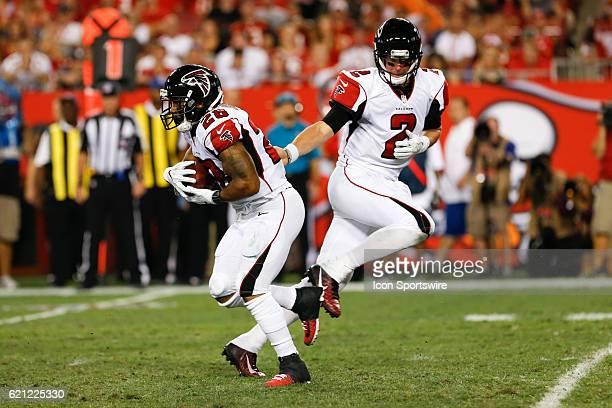 Atlanta Falcons running back Terron Ward takes a hand off from Atlanta Falcons quarterback Matt Ryan during the NFL game between the Atlanta Falcons...