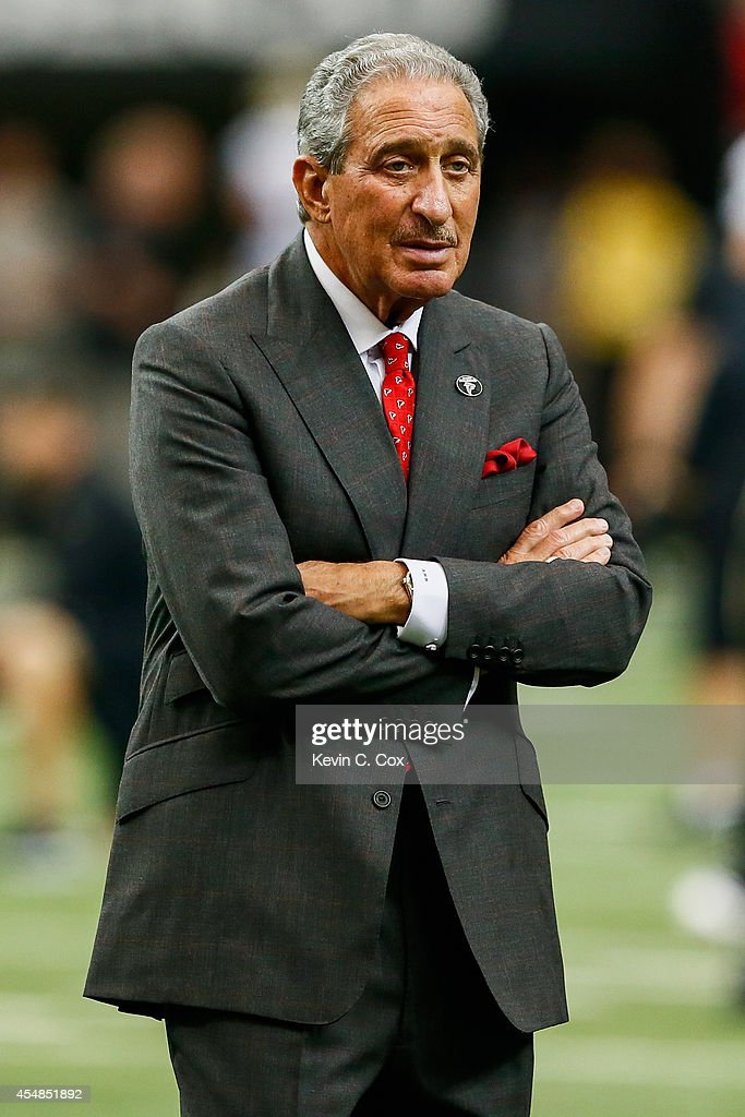Atlanta Falcons team owner Arthur Blank walks on the field during warm ups prior to the game against the New Orleans Saints at the Georgia Dome on...