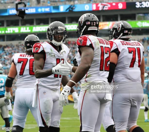 Atlanta Falcons wide receiver Julio Jones congrats Atlanta Falcons wide receiver Mohamed Sanu for his touchdown during 1st half of the Carolina...