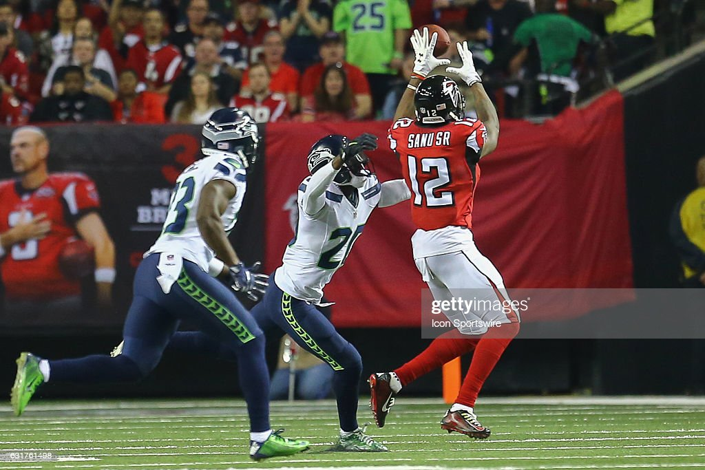 Atlanta Falcons wide receiver Mohamed Sanu (12) catches a ball for a first down of the NFC Divisional Playoff game between the Seattle Seahawks and the Atlanta Falcons on January 14, 2017, at the Georgia Dome in Atlanta, Georgia. The Falcons beat the Seahawks 36-20.