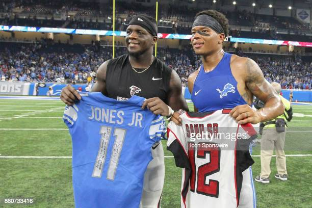 Atlanta Falcons wide receiver Mohamed Sanu left and Detroit Lions wide receiver Marvin Jones Jr right pose for photographs after they presented each...