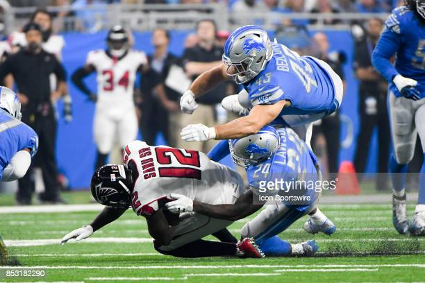 Atlanta Falcons wide receiver Mohamed Sanu makes a catch and is tackled by Detroit Lions cornerback Nevin Lawson and Detroit Lions linebacker Nick...