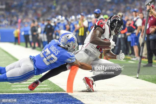 Atlanta Falcons wide receiver Mohamed Sanu makes a catch with Detroit Lions cornerback Quandre Diggs defending him at the goal line for a touchdown...