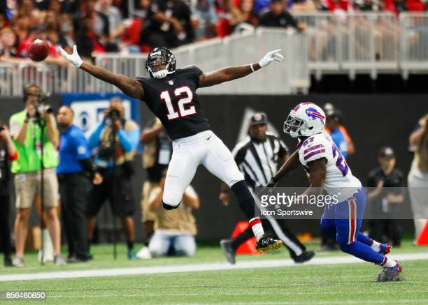 Atlanta Falcons wide receiver Mohamed Sanu stretches out but comes up short of the reception as he is defended by Buffalo Bills cornerback...