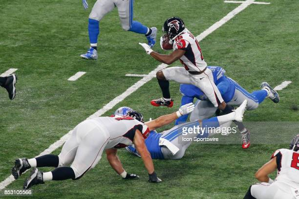 Atlanta Falcons wide receiver Taylor Gabriel hurdles Detroit Lions defensive players while running with the ball after catching a pass defensive...