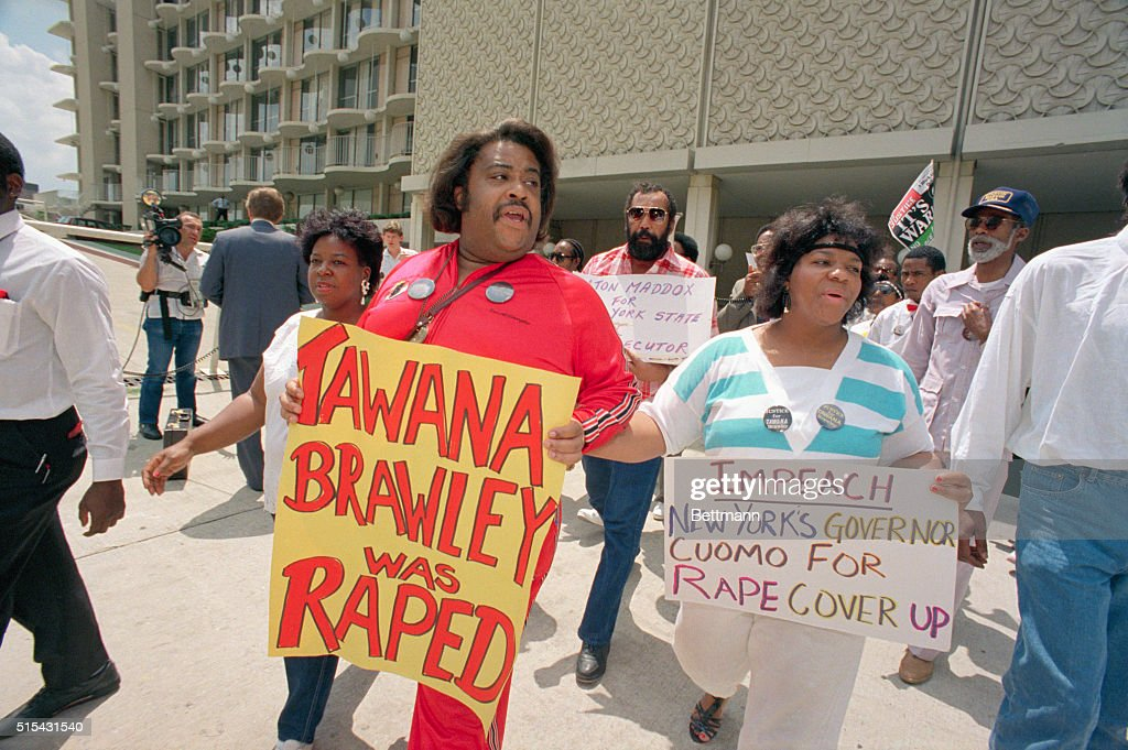 Glenda Brawley, right, mother of Tawana Brawley, and her advisor, Reverend Al Sharpton, picket outside the hotel of New York governor Mario Cuomo, July 18. They are demanding justice for Tawana Brawley and are at odds with the governor.