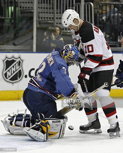 Atlanta goalie Kari Lehtonen battles Devils Devils center Erik Rasmussen for the puck during the game between the Atlanta Thrashers and the New...