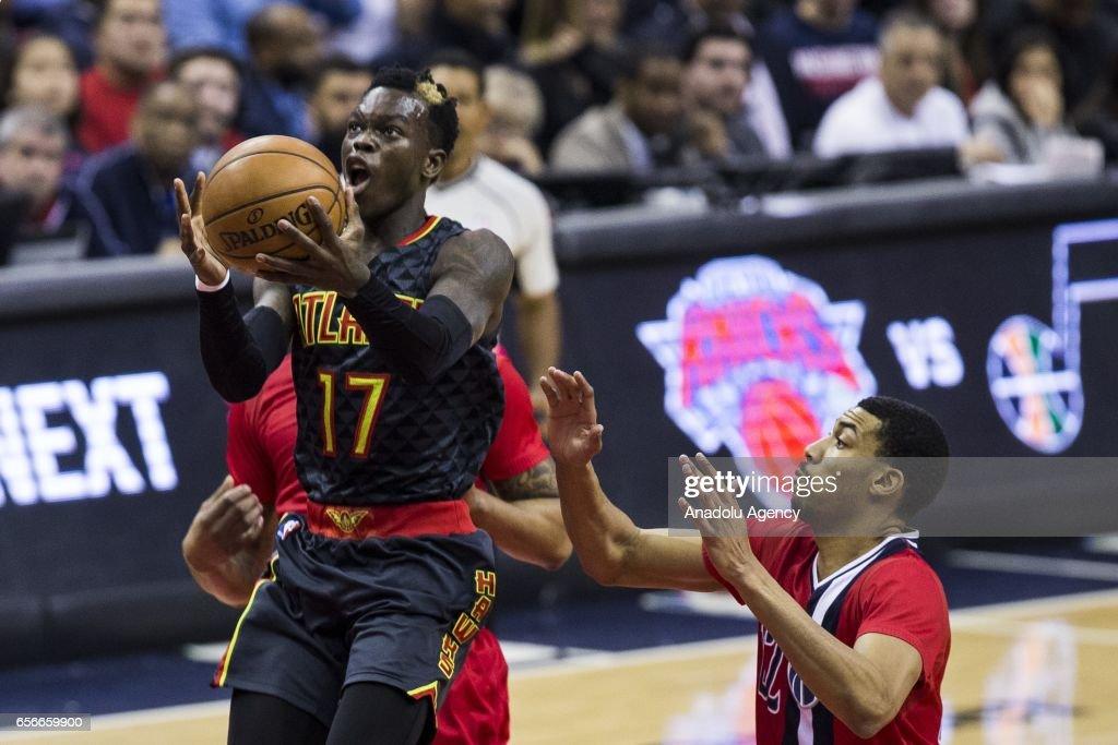 Atlanta Hawk Dennis Schroder (17) flies towards the basket past Washington Wizard Otto Porter (22) at the Verizon Center in Washington, USA on March 22, 2017. Atlanta leads Washington 46-40 at halftime.