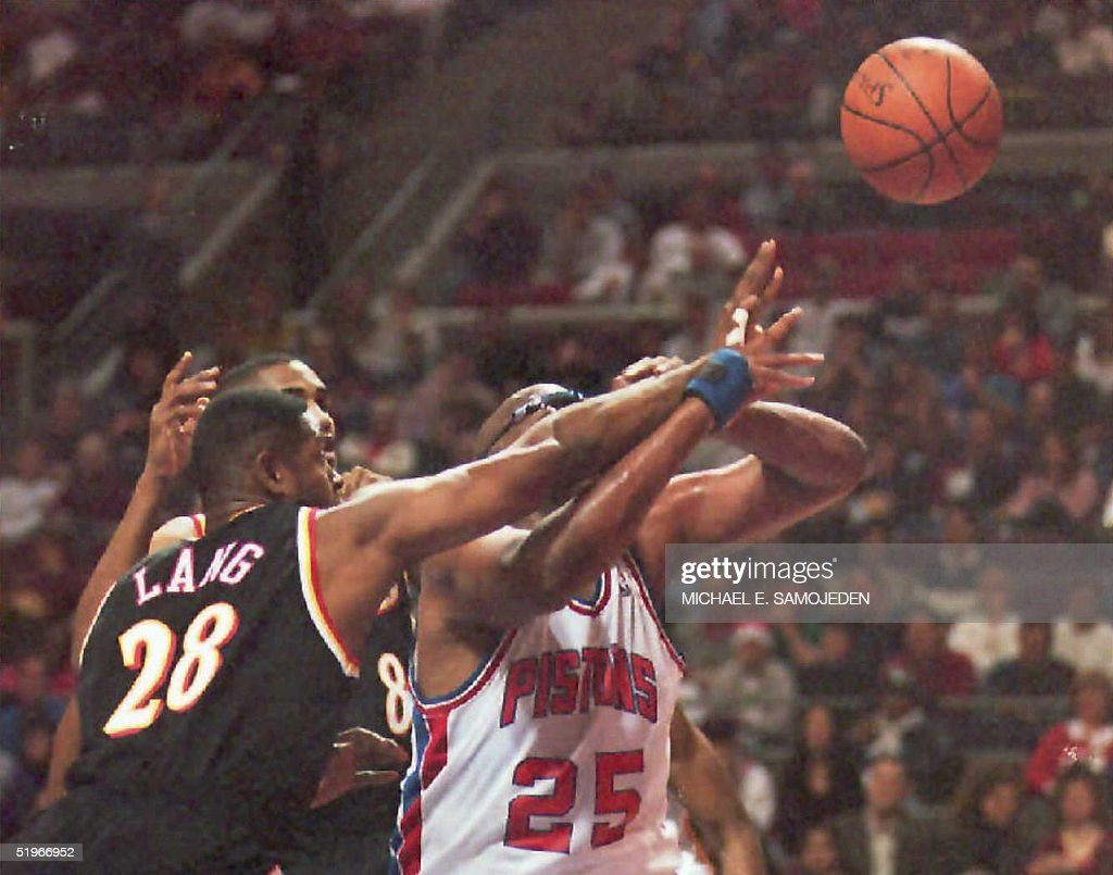 Atlanta Hawks Andrew Lang and teammte Steve Smith tangle arms with Detroit Pistons Oliver Miller as they try for the ball in the first quarter of...