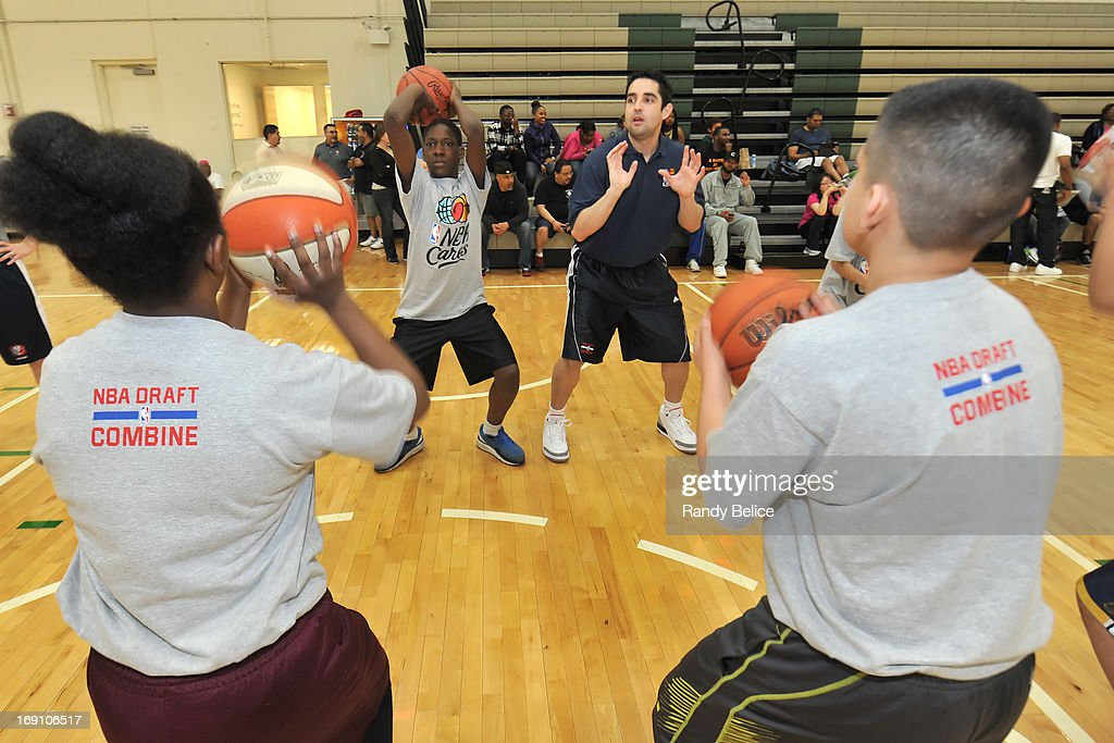 Atlanta Hawks Assistant Coach Kenny Atkinson leads a shooting drill during a NBA Cares Basketball Clinic as part of the 2013 NBA Draft Combine on May 18, 2013 at Quest Multiplex in Chicago, Illinois.