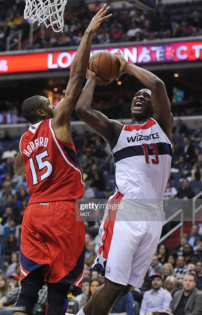 Atlanta Hawks center Al Horford (15) blocks a shot by Washington Wizards small forward Trevor Ariza (1) in the third quarter at the Verizon Center in Washington, D.C., Saturday, January 12, 2013. The Wizards defeated the Hawks, 93-83.