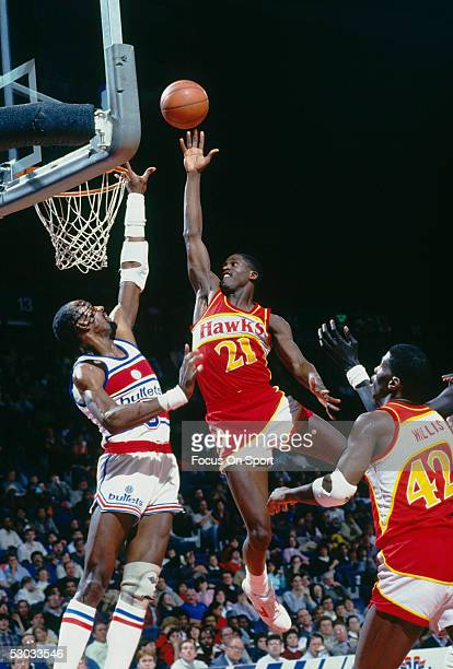 Atlanta Hawks' Dominique Wilkins jumps for a layup against the Washington Bullets during a game at Capital Centre circa 1986 in Washington DC NOTE TO...