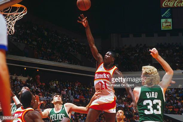 Atlanta Hawks' Dominique Wilkins jumps for a layup against the Boston Celtics NOTE TO USER User expressly acknowledges and agrees that by downloading...