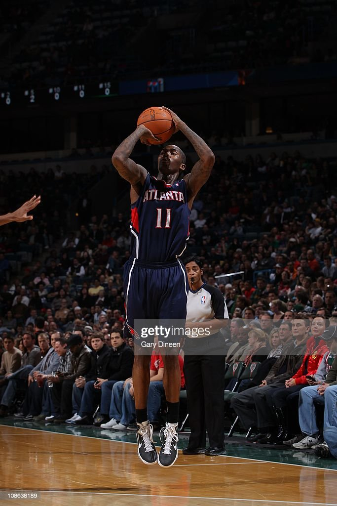 Atlanta Hawks guard <a gi-track='captionPersonalityLinkClicked' href=/galleries/search?phrase=Jamal+Crawford&family=editorial&specificpeople=201851 ng-click='$event.stopPropagation()'>Jamal Crawford</a> #11 goes for a jump shot during the game against the Milwaukee Bucks on January 26, 2011 at the Bradley Center in Milwaukee, Wisconsin. The Bucks won 98-90.