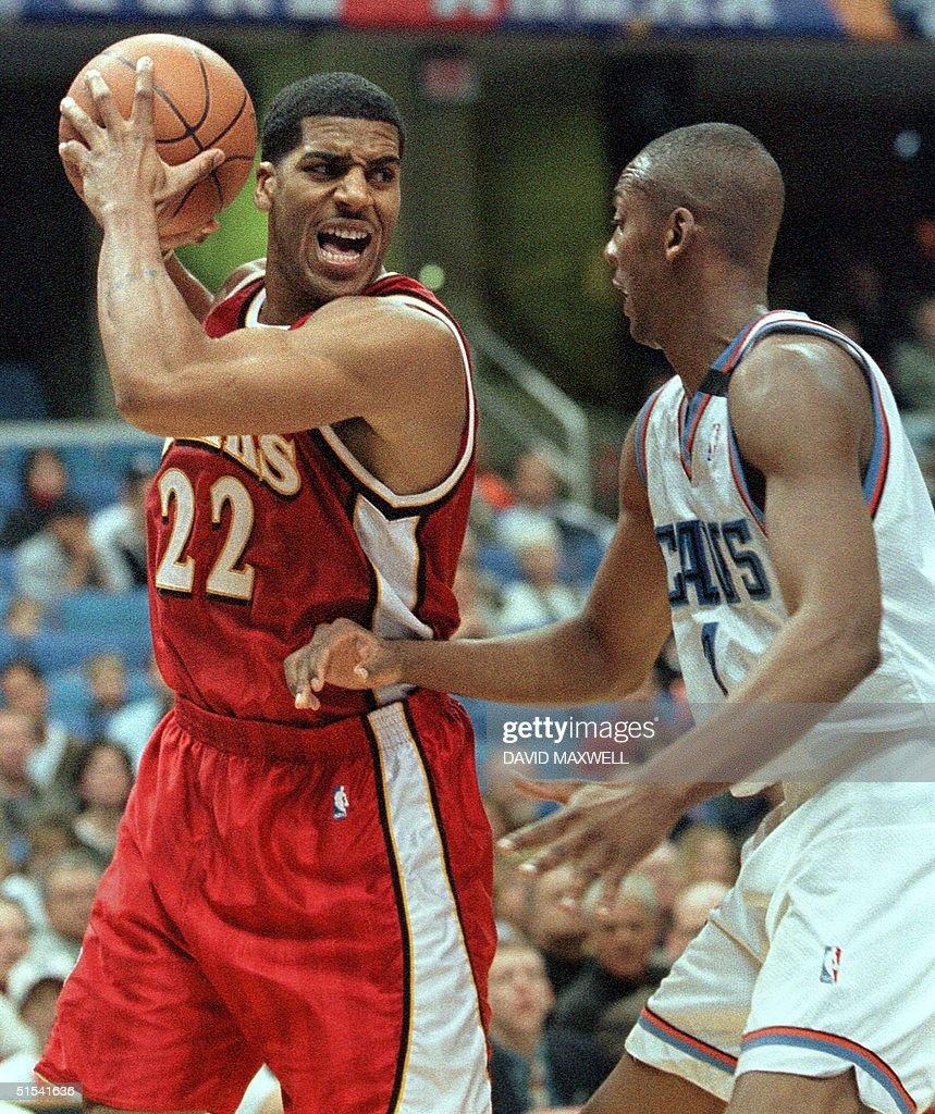 Atlanta Hawks guard Jim Jackson L draws the ball