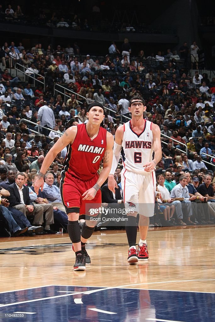 Atlanta Hawks guard Kirk Hinrich and Miami Heat point guard Mike Bibby walk on court during the game on March 18 2011 at Philips Arena in Atlanta...