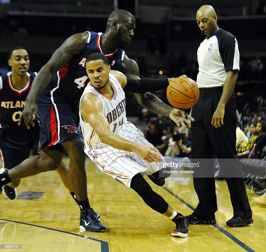 Atlanta Hawks' Ivan Johnson (44) strips the ball from Charlotte Bobcats' D.J. Augustin (14) during the first half of their preseason game at Time Warner Cable Arena in Charlotte, North Carolina on Monday, December 19, 2011.