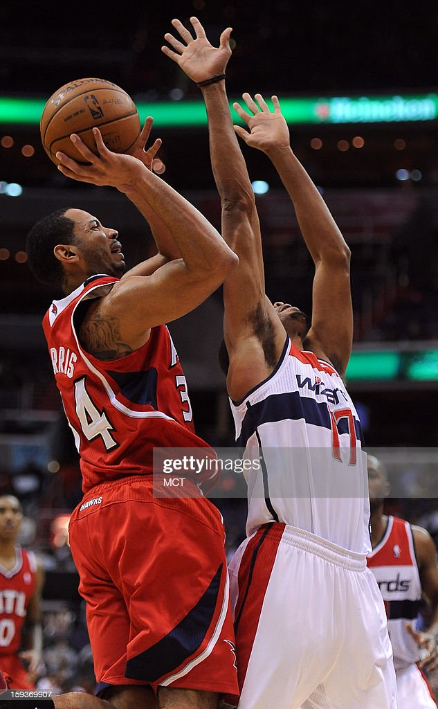 Atlanta Hawks point guard Devin Harris (34) gets fouled by Washington Wizards shooting guard Garrett Temple (17) on a shot attempt in the second quarter at the Verizon Center in Washington, D.C., Saturday, January 12, 2013. The Wizards defeated the Hawks, 93-83.