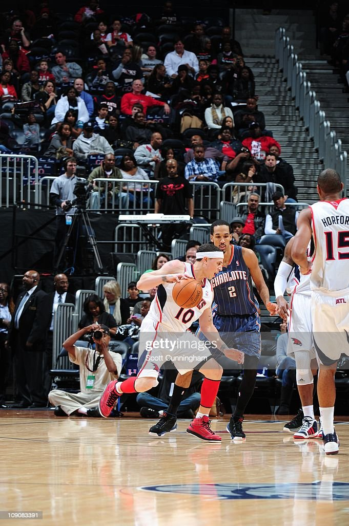 Atlanta Hawks point guard Mike Bibby drives to the basket during the game against the Charlotte Bobcats on February 12 2011 at Philips Arena in...