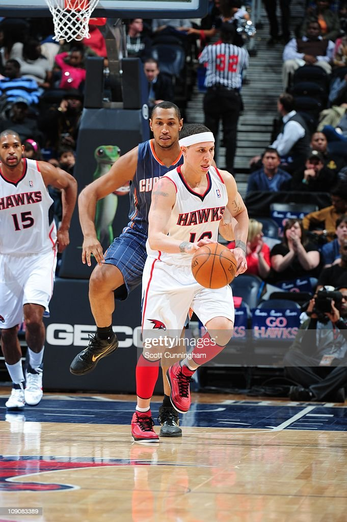 Atlanta Hawks point guard Mike Bibby protects the ball during the game against the Charlotte Bobcats on February 12 2011 at Philips Arena in Atlanta...
