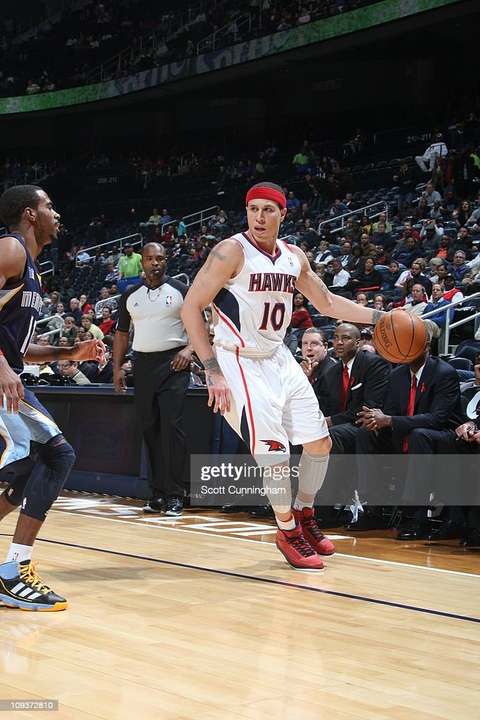 Atlanta Hawks point guard Mike Bibby protects the ball during the game against the Memphis Grizzlies on December 1 2010 at Philips Arena in Atlanta...