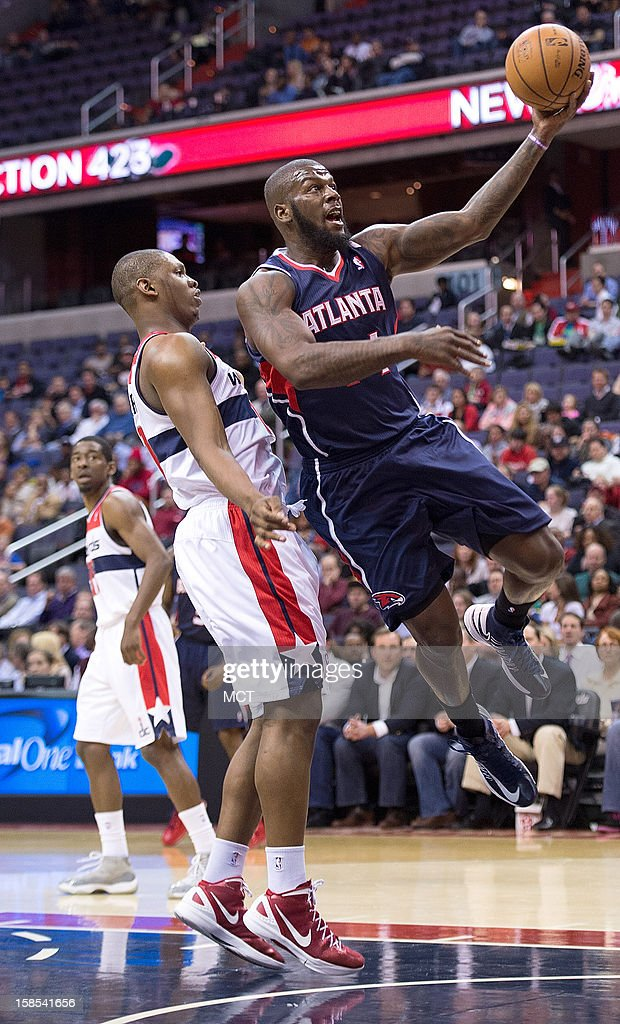 Atlanta Hawks power forward Ivan Johnson (44) drives past Washington Wizards power forward Kevin Seraphin (13) during the first half of their game played at the Verizon Center in Washington, D.C., Tuesday, December 18, 2012.