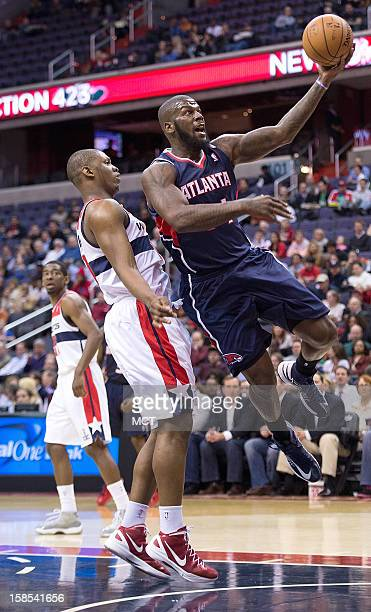Atlanta Hawks power forward Ivan Johnson drives past Washington Wizards power forward Kevin Seraphin during the first half of their game played at...