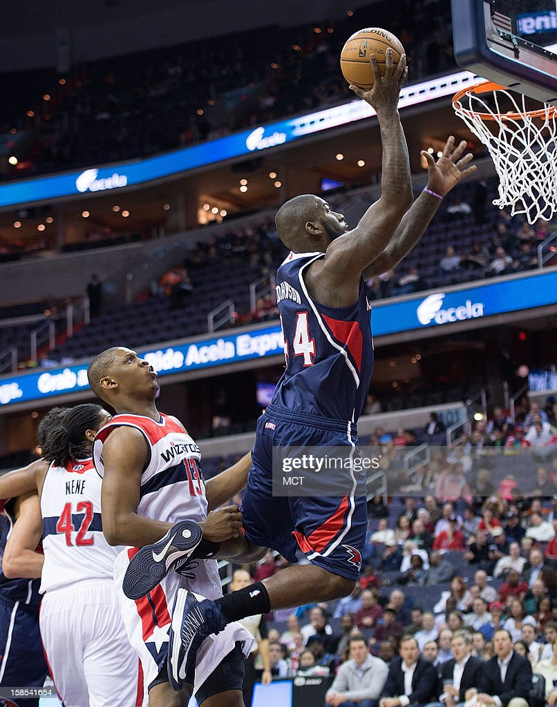 Atlanta Hawks power forward Ivan Johnson (44) scores over Washington Wizards power forward Kevin Seraphin (13) during the first half of their game played at the Verizon Center in Washington, D.C., Tuesday, December 18, 2012.
