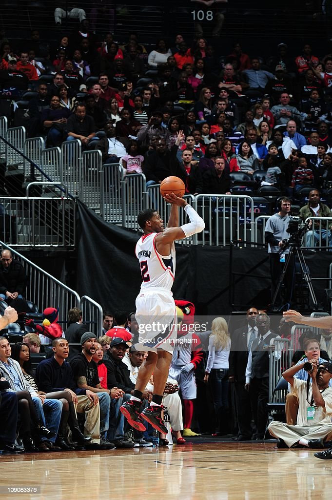 Atlanta Hawks shooting guard <a gi-track='captionPersonalityLinkClicked' href=/galleries/search?phrase=Joe+Johnson+-+Basketball+Player&family=editorial&specificpeople=201652 ng-click='$event.stopPropagation()'>Joe Johnson</a> #2 goes for a jump shot during the game against the Charlotte Bobcats on February 12, 2011 at Philips Arena in Atlanta, Georgia. The Bobcats won 88-86.