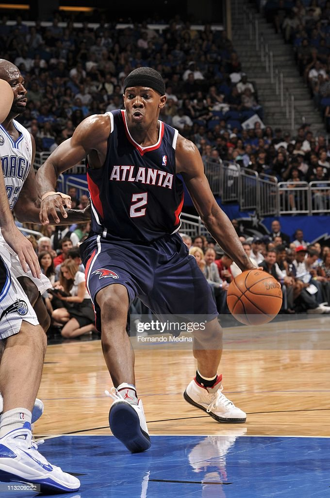 Atlanta Hawks shooting guard <a gi-track='captionPersonalityLinkClicked' href=/galleries/search?phrase=Joe+Johnson+-+Basketball+Player&family=editorial&specificpeople=201652 ng-click='$event.stopPropagation()'>Joe Johnson</a> #2 protects the ball during an action against the Orlando Magic in Game Five of the Eastern Conference Quarterfinals in the 2011 NBA Playoffs on April 26, 2011 at the Amway Center in Orlando, Florida.