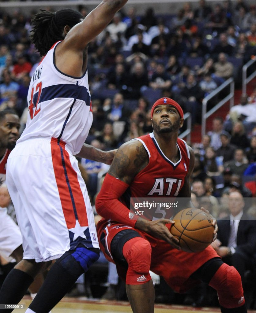 Atlanta Hawks small forward Josh Smith (5) looks for room to put up a shot against Washington Wizards center Nene (42) in the second quarter at the Verizon Center in Washington, D.C., Saturday, January 12, 2013. The Wizards defeated the Hawks, 93-83.