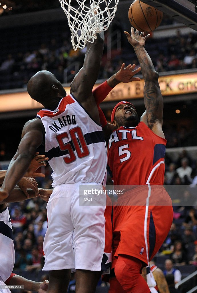 Atlanta Hawks small forward Josh Smith (5) scores against Washington Wizards center Emeka Okafor (50) in the first quarter at the Verizon Center in Washington, D.C., Saturday, January 12, 2013.