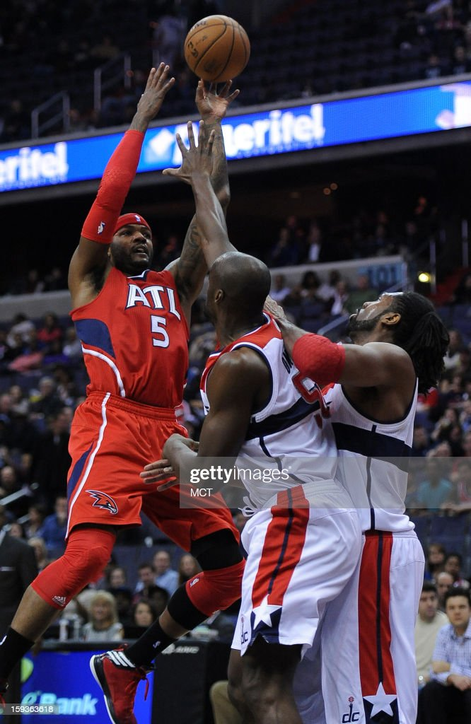 Atlanta Hawks small forward Josh Smith (5) shoots over Washington Wizards center Emeka Okafor (50) and the Wizards' Nene (42) in the first quarter at the Verizon Center in Washington, D.C., Saturday, January 12, 2013.