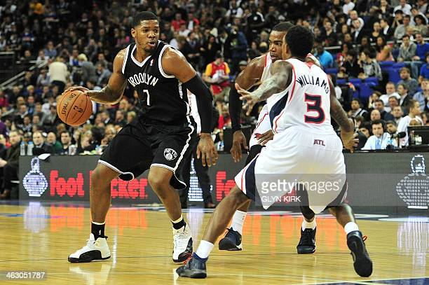 Atlanta Hawks' US player Louis Williams tries to block Brooklyn Nets' US player Joe Johnson during the NBA Global Games London 2014 basketball match...