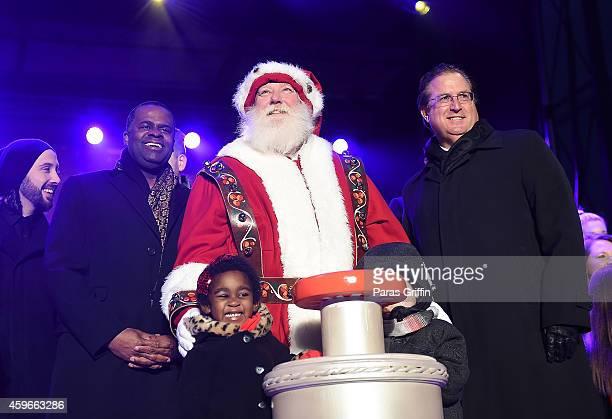 Atlanta Mayor Kasim Reed onstage at Macy's 67th Annual Great Tree Lighting at Macy's Lenox Square on November 27 2014 in Atlanta Georgia