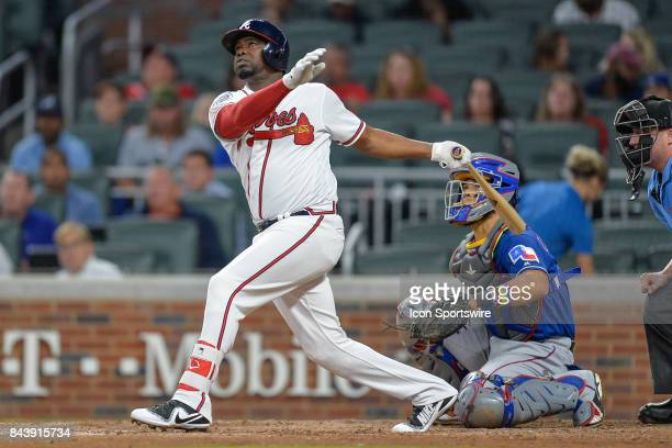 Atlanta pinch hitter Adonis Garcia hits a fly ball during a game between the Texas Rangers and the Atlanta Braves on August 25 2017 at SunTrust Park...