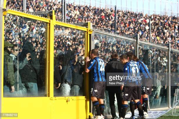 Atlanta players try to talk to fans at the Serie A match between Atalanta and AC Milan on November 11 2007 in Bergamo Italy The match was suspended...