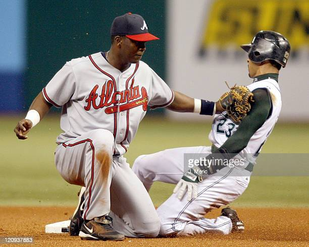 Atlanta shortstop Edgar Renteria applies the tag to Tampa Bay's Julio Lugo during Friday night's action at Tropicana Field in St Petersburg Florida...