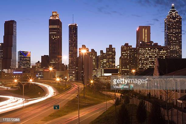 Atlanta skyline with motion-blurred cars at dusk