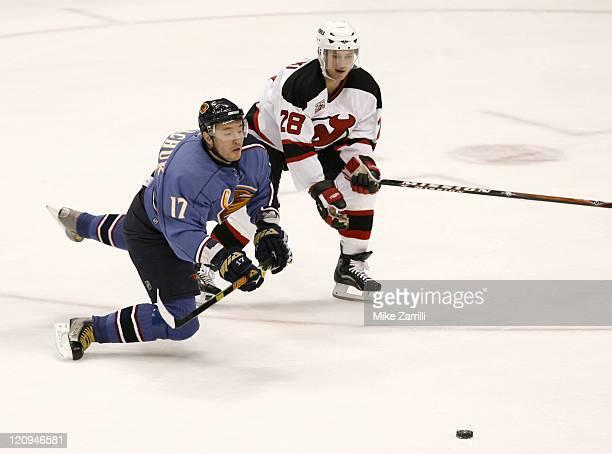 Atlanta Thrashers forward Ilya Kovalchuk and New Jersey Devils defenseman Brian Rafalski chase the puck during the game at the Philips Arena in...