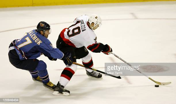 Atlanta Thrashers forward Ilya Kovalchuk harasses Ottawa center Jason Spezza during the game between the Atlanta Thrashers and the Ottawa Senators at...