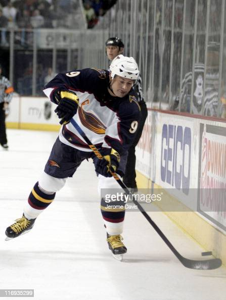Atlanta Thrashers' Marc Savard shoots the puck into the zone during a game versus the Buffalo Sabres at the HSBC Arena in Buffalo NY March 1 2006...