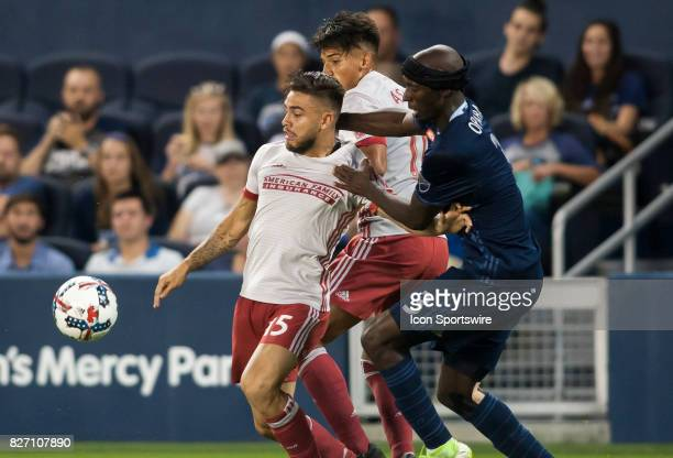Atlanta United FC Forward Hector Villalba battles with Sporting Kansas City Defender Ike Opara for possession of the ball during the match between...