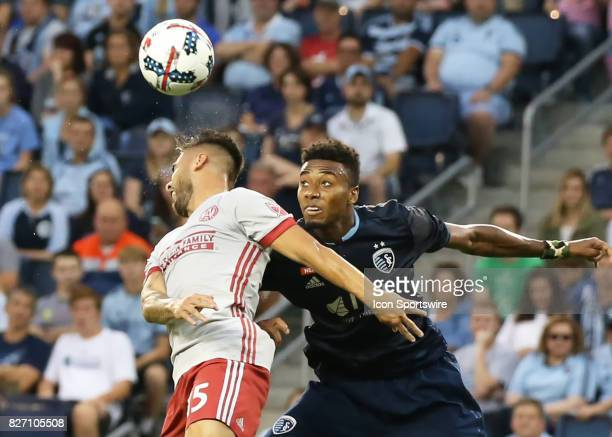 Atlanta United forward Hector Villalba beats Sporting Kansas City defender Saad AbdulSalaam to the header in the first half of an MLS match between...