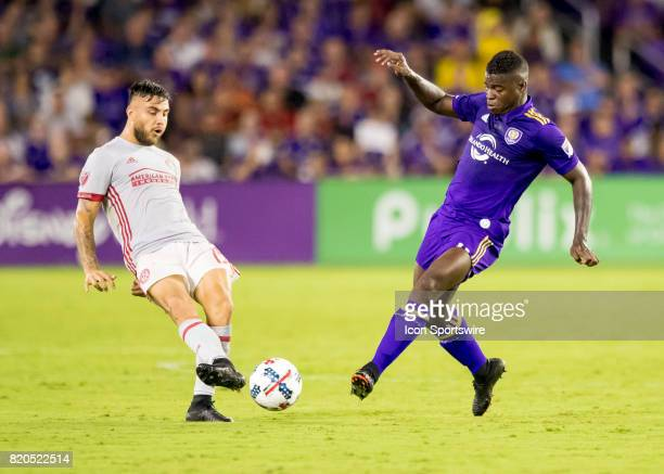 Atlanta United forward Hector Villalba clears a ball from Orlando City SC forward Carlos Rivas during the MLS soccer match between the Orlando City...